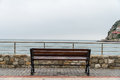 Empty wooden bench with viewpoint looking out to sea cloudy weather Royalty Free Stock Photography