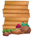 Empty wooden boards near the rocks with a worm Royalty Free Stock Photo
