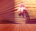 Empty wooden deck table with beautiful little flower in a book background. Ready for product display montage. Aroma of stor Royalty Free Stock Photo