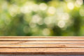 Empty wooden deck table on bokeh background Royalty Free Stock Photo