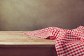 Empty wooden deck table with checked tablecloth for product montage display Royalty Free Stock Photo