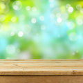 Empty wooden deck table over blurred bokeh nature background Royalty Free Stock Photo
