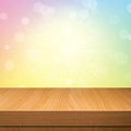 Empty wooden deck table over sunset  bokeh background Royalty Free Stock Photo