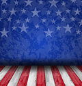 Empty wooden deck table over USA flag background Royalty Free Stock Photo