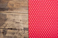 Empty wooden deck table with red tablecloth with polka dots Royalty Free Stock Images