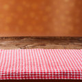 Empty wooden deck table with tablecloth for product montage Stock Photo