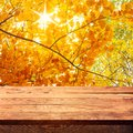 Empty wooden deck table with tablecloth for product montage autumn landscape free space for your text Royalty Free Stock Photography