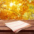 Empty wooden deck table with tablecloth for product montage autumn landscape free space for your text Stock Image