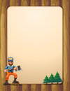 An empty wooden frame with a lumberjack holding an axe across th illustration of the pine trees Stock Images