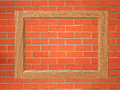 Empty wooden frame on the red brick wall Royalty Free Stock Photo