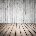 Empty wooden interior with white wall and brown floor Royalty Free Stock Image