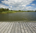 Empty wooden jetty on the lake shore Stock Photography