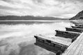 Empty wooden mole on blue alps lake wharf for hired boats in marina ready trip ships Stock Photos