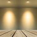 Empty wooden perspective platform with lamp shade from small lamp on abstract white wall background with copy space used as Royalty Free Stock Photography