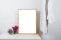 Empty wooden picture frame on the table, art print mock-up Royalty Free Stock Photo