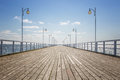 Empty wooden pier old over the sea shore with copy space Stock Photo