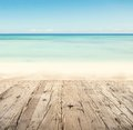 Empty wooden pier with view on sandy beach free space for text or product placement Stock Photos