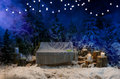 Empty wooden swing with a blanket in the evening in a snow-covered park or a forest concept about Christmas and New Year holiday Royalty Free Stock Photo