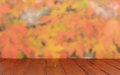 Empty wooden table over autumn leaves bokeh background ready for product montage Stock Photo
