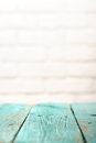 Empty wooden table painted turquoise and white brick wall copysp Royalty Free Stock Photo