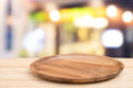 Empty wooden tray on perspective wooden table on top over blurcoffee shop background. Can be used mock up for montage products di