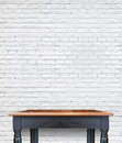 Empty wooden vintage table on brick tiles wall,Mock up for displ Royalty Free Stock Photo