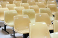 Empty yellow plastic chairs Royalty Free Stock Photo