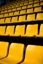 Empty yellow seats Royalty Free Stock Photo