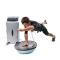 EMS fitness man doing side plank with toe touch on bosu ball Royalty Free Stock Photo