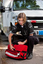 EMS Professional with Portable Oxygen Unit Stock Photo