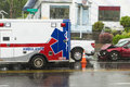 Emt vehicle responding to a traffic accident crash caused by rain Royalty Free Stock Photography