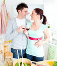 Enamored couple drinking wine in the kitchen Stock Image