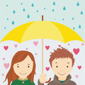 Enamored under an umbrellla loving couple umbrella Stock Photo