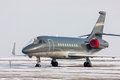 Encased private jet in a cold winter airport Royalty Free Stock Photography