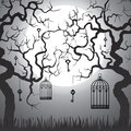Enchanted forest with gnarled trees and cages at halloween night Stock Photography