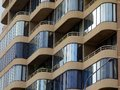 Enclosed balconies modern apartment building glass on multi level Stock Images