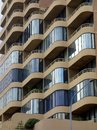 Enclosed balconies modern apartment building glass on multi level Royalty Free Stock Photo