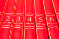 Encyclopedia row of red books on a shelf Royalty Free Stock Images