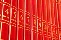 Encyclopedia row of red books on a shelf Stock Photo