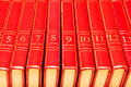Encyclopedia row of red books on a shelf Stock Image
