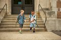 End of school two boys leaving happy Royalty Free Stock Photography