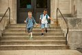End of school two boys leaving happy Royalty Free Stock Image