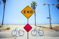 The end sign on the venice beach los angeles california a traffic surrounded by bicycle parking mounted at promenade of a sunny Royalty Free Stock Image