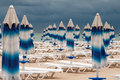 The end of summer and beach this is back on sunshades has been closed heavy clouds clung to seaside Royalty Free Stock Photo