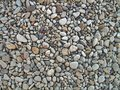 Endless dry sea pebbles, texture, background. Pebbles gray, small, oval. Royalty Free Stock Photo