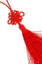 Endless knot silk tassel close up of bright red eternal isolate on white buddhist icon Stock Photography