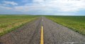 Endless road in the grassland
