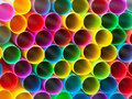 Ends of multicoloured plastic drinking straws abstract background from end close up Stock Photo