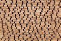 The ends of processed lumber stacked on the open air Royalty Free Stock Photo
