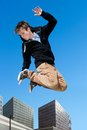 Energetic boy jumping in city portrait of high Royalty Free Stock Photo